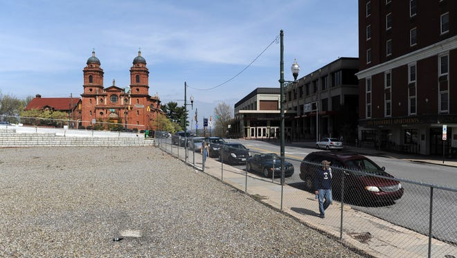 """The so-called """"Pit of Despair,"""" a city-owned lot near the Basilica of St. Lawrence, is between Haywood Street and Page Avenue."""