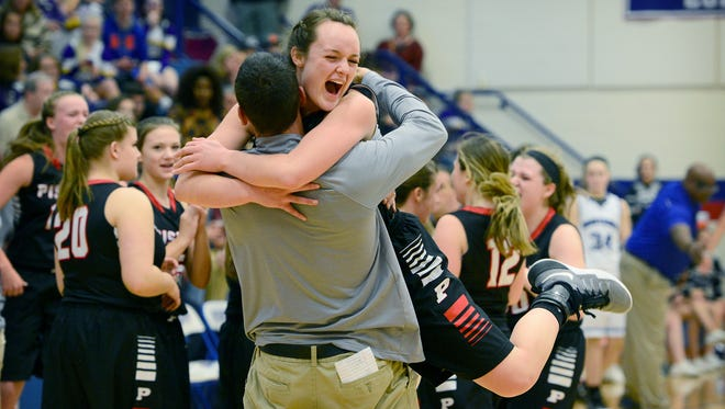 Pisgah's Maddie Webb jumps into the arms of coach Brandon Holloway following the Black Bears' win in the Feb. 16 WNC Athletic Conference tournament's championship game.