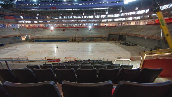 The seats being installed at Little Caesars Arena in Detroit.