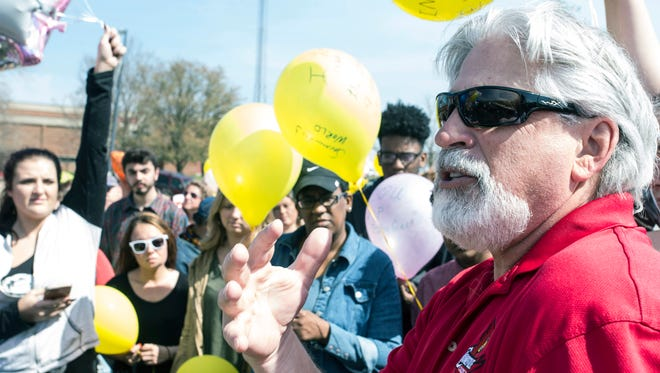 Dean Walker addresses a crowd gathered for a balloon release to honor his daughter Savannah at Ballard High on Saturday afternoon. March 25, 2017