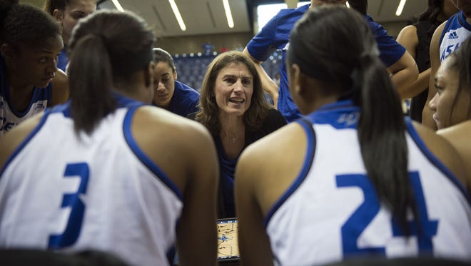 UNC Asheville women's basketball coach Brenda Mock Kirpatrick and the Bulldogs have won back-to-back Big South Conference tournament championships.