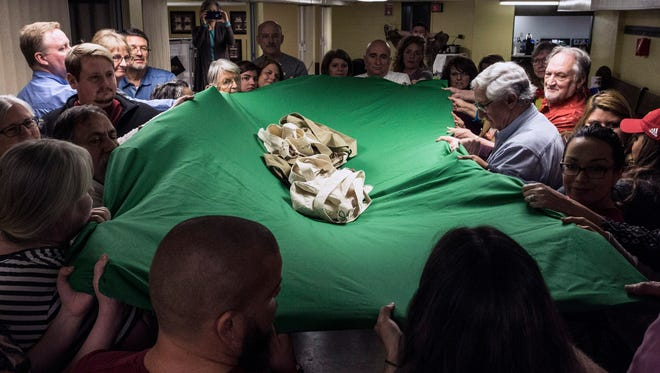 A weighted blanket collectively supported by the participants in a Warrior's Heart  celebration shows the strength of acting as a community. 3/9/17