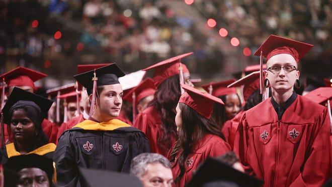 UL students stand as there are acknowledged during the 2016 Fall Commencement Ceremony at the Cajundome Dec. 16, 2016.