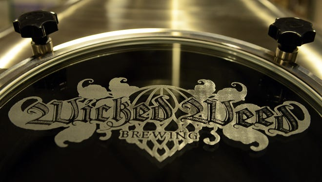 Scenes at the Wicked Weed production brewery in Candler during a media tour in 2014.