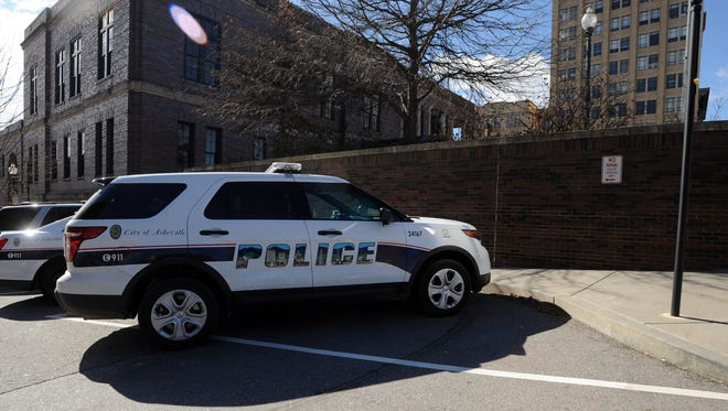 An Asheville Police Department vehicle next to the city's downtown police station.