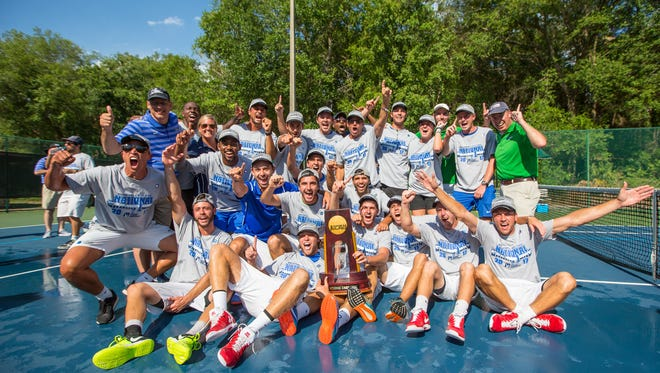 The University of West Florida men's tennis team celebrates a 5-2 victory over Barry University to win the Division II Men's Tennis Championship held at Sanlando Park on May 12, 2017 in Altamonte Springs, Florida.