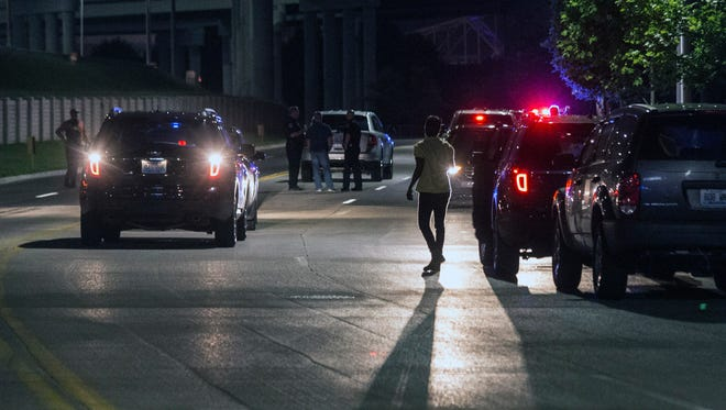 LMPD shut down a portion of River Road just west of the Big Four Bridge to collect evidence after a shooting that left multiple injured and one dead on Monday night. May 29, 2017