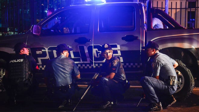 Filipino policemen take position outside the Resort World Manila hotel in Pasay, south of Manila, on June 2, 2017.