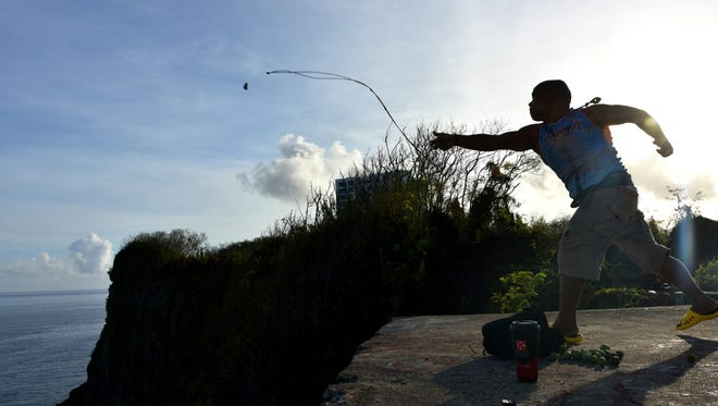 Roman Dela Cruz is shown slinging from the Oka Point clifftop on May 15, 2016.