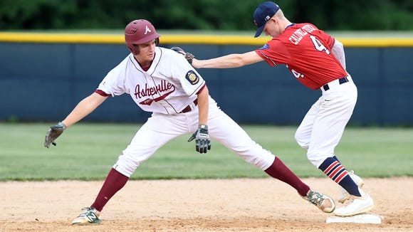 Griffin Mease, left, had the game-winning hit for Asheville Post 70 on Tuesday night.