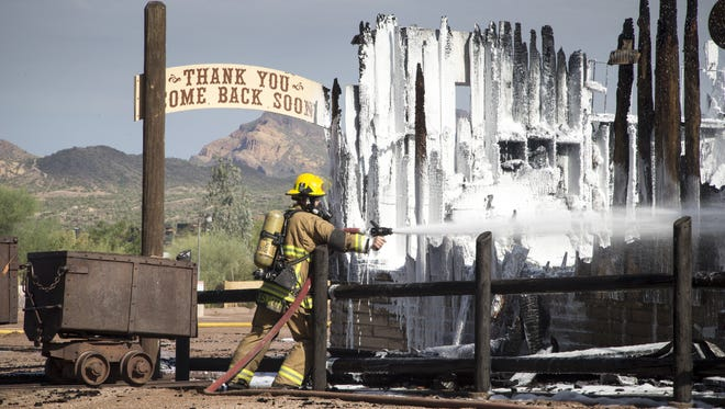 Superstition Fire and Medical officials on the scene of the Mining Camp Restaurant fire, July 25, 2017, 6100 E. Mining Camp Street, Apache Junction. The historic restaurant is a total loss after the fire.