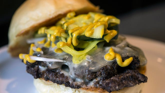 The Haus Burger at The Gralehaus is two grilled patties served with aged cheddar, onion, b&b pickles, and yellow mustard on a brioche bun. For $1 more, the burger can have beer cheese added. 8/11/17