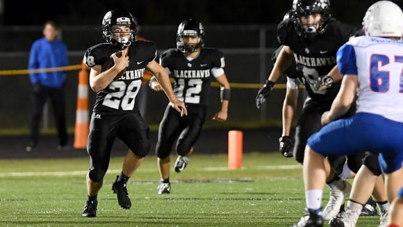 North Buncombe's Skylar Jutras runs the ball during the Blackhawks' game against West Henderson at North Buncombe High School on Thursday, Sept. 7, 2017. The Falcons defeated the Blackhawks 42-7.