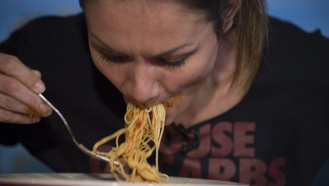 Michelle Lesco of Tucson set the Guinness record for speed-eating a plate of pasta.