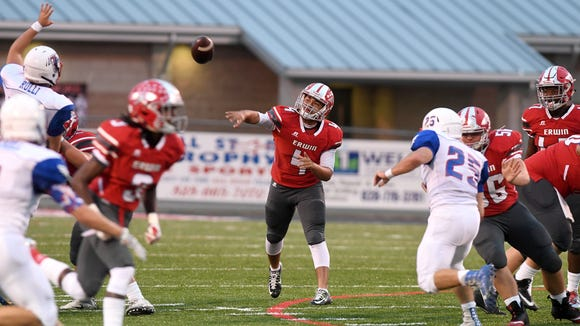 Erwin's Kendrick Weaver throws a pass during their game against West Henderson at Erwin High School on Friday, Sept. 29, 2017. The Warriors defeated the Falcons 46-21.