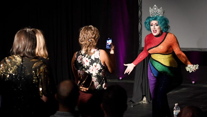 The crowd lines up for hugs and congratulations as Anna Tomical performs her first song after winning the title of Miss Blue Ridge Pride during the Miss Blue Ridge Pride pageant at the Masonic Temple on Thursday, Sept. 28, 2017.