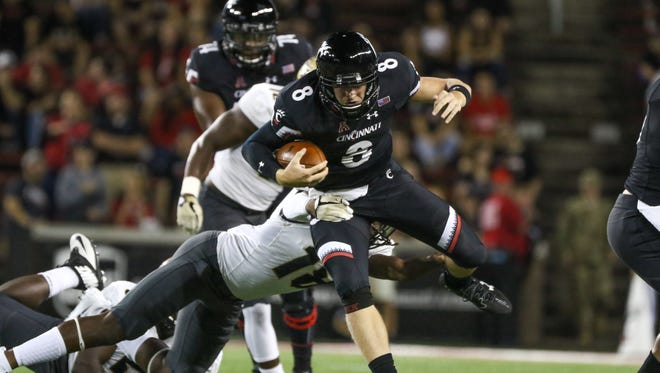 UC's Hayden Moore rushes down the field and through UCF's defense during the UC vs. UCF Knights game at Nippert Stadium on Saturday Oct. 7, 2017.