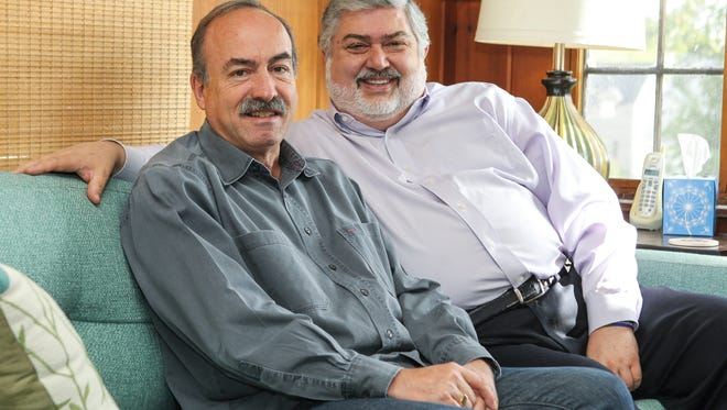 The Rev. David Meredith (right) and his husband, Jim Schlachter, at their home in Madeira.