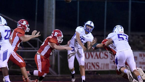 Brevard quarterback Mitchell Johnson throws a pass