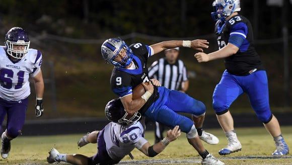 Polk County quarterback Dillon Overholt gets taken