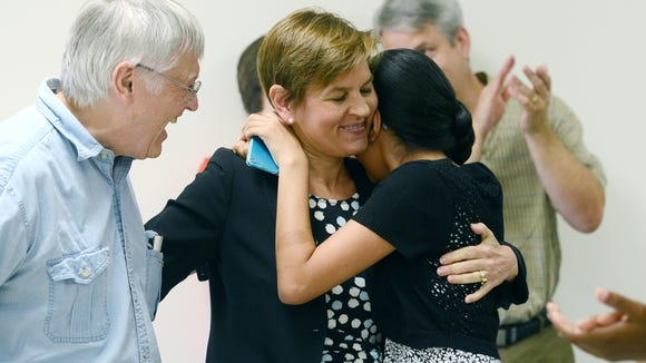 Holly Jones gets a hug from her husband Bob Falls, left, and daughter Gabriela in this 2015 photo after announcing that she was running for for lieutenant governor.