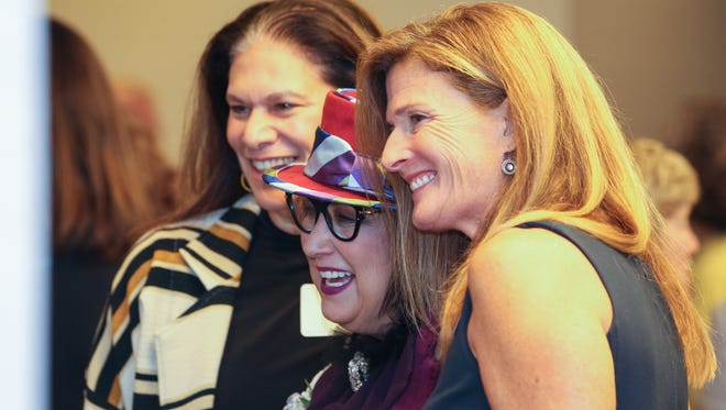 Current and former Women of the Year (from right) Lauren Hannan Schafer, Pam Kravetz and Tamara Harkavy pose for photos before the Women of the Year luncheon in 2017.