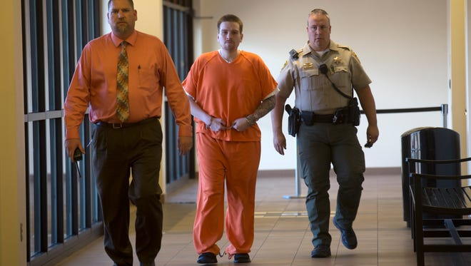 Defendant Timothy Serrano is escorted into court for his sentencing on Tuesday at Aztec District Court.