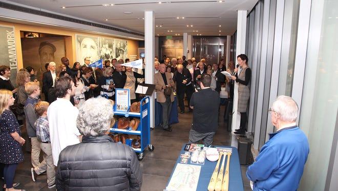 "Yogi Berra Museum Executive Director Eve Schaenen introduces the museum's new exhibition, ""New York City's Golden Boys: 76 Baseball Portraits, 1946-1960,"" on Nov. 7."