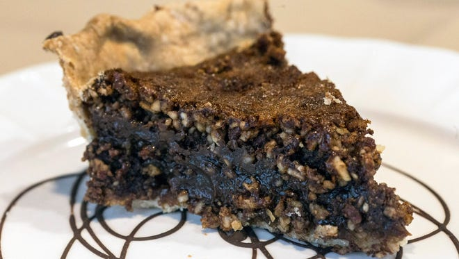 The deep chocolate color of the pecan pie at Anoosh Bistro provides great contrast to the heavy pecan texture of the dessert. 11/7/17