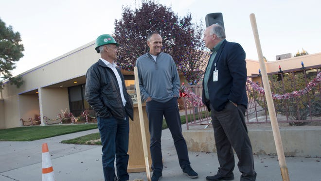 Bill Florez, executive vice president of the Jaynes Corporation, left, Farmington Mayor Tommy Roberts and Farmington City Manager Rob Mayes talk on Tuesday after a groundbreaking ceremony for the expansion at the Farmington Civic Center.