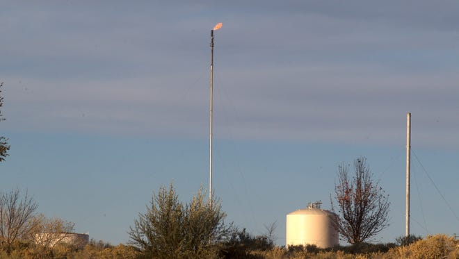 A flaring stack is pictured near Riverview Golf Course on Tuesday, Nov. 14, 2017 in Kirtland.