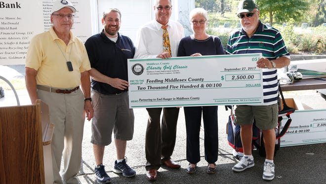 Feeding Middlesex County, was launched before a crowd of 200 golfers and guests at the Middlesex County Charity Golf Classic at Tamarack Golf Course this fall. Jane Brady, chair of Feeding Middlesex County, accepted a $2,500 donation. The new organization was formed to fund and support Middlesex County's food bank, MCFOODS (Middlesex County Food  Organization and Outreach Distribution Services) which serves more than 100 food pantries and social service groups in the 25 municipalities in the county.