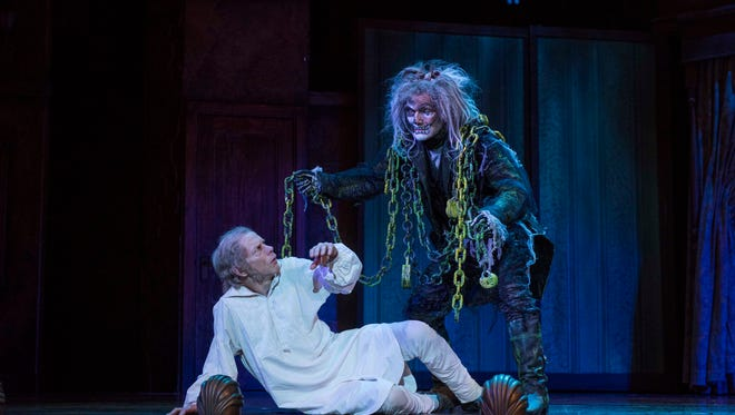 "Marley's Ghost (Jonathan Smoots), wearing the chains he forged in life, has a message for his old partner Scrooge (Jonathan Wainwright) in ""A Christmas Carol,"" performed by Milwaukee Repertory Theater."