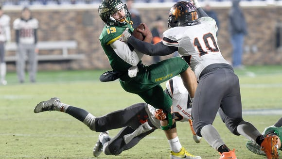 Reynolds quarterback Alex Flinn gets taken down by