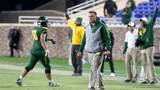 Reynolds head coach Shane Laws reacts to a call on the field during the NCHSAA 3AA state championship football game at Wallace Wade Stadium at Duke University in Durham on Saturday, Dec. 9, 2017. The Rockets lost 27-17 to the Wildcats.