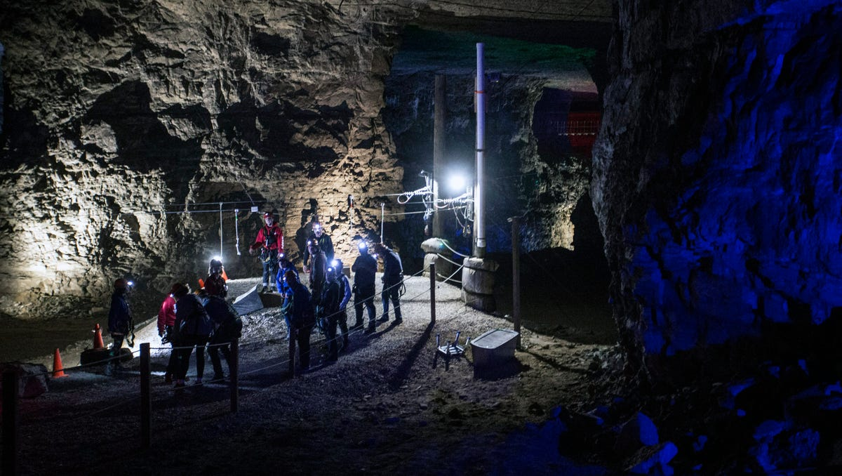 Louisville Mega Cavern explorers don mining helmets with miniature lights during a recent zip line tour. 11/22/17