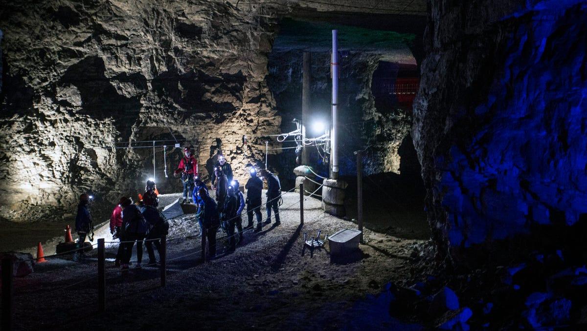 Louisville Mega Cavern explorers don mining helmets with miniature lights during a recent zip line tour. 11/22/17