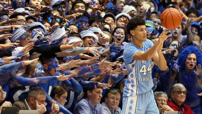 The Cameron Crazies taunt North Carolina's Justin Jackson as he throws the ball in during the second half of a game Feb. 9, 2017 against the Duke Blue Devils at Cameron Indoor Stadium.