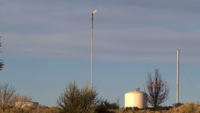 A flaring stack is pictured near Riverview Golf Course in Kirtland in this 2017 file photo.