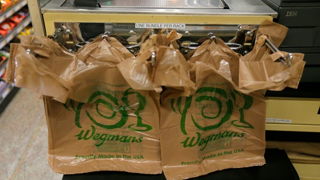 Bundles of plastic bags are placed at the end of a check-out line at Wegmans in Ocean Twp., NJ Tuesday January 16, 2018.