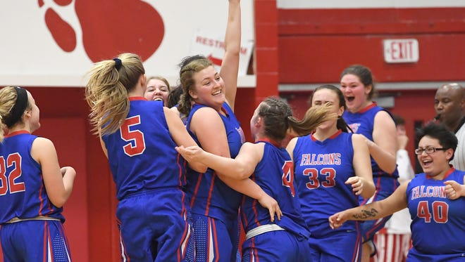 West Henderson's Izzy Bell celebrates after making a buzzer-beating three-point-shot to win the game over Hendersonville during their game at Hendersonville High School on Tuesday, Jan, 23, 2018. The Falcons won 58-55.