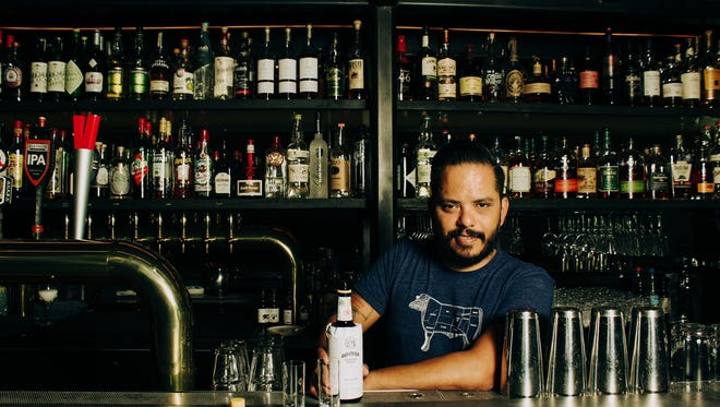 Truss & Twine bar manager Dave Castillo pours Angostura bitters shots in Palm Springs.