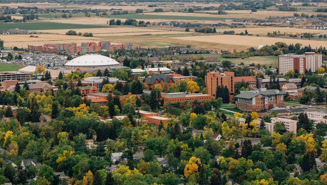 Aerial view of Montana State University, Bobcat Stadium, Brick Breeden Fieldhouse and the surrounding community of Bozeman, Mont., seen on Saturday, Sept. 24, 2016.