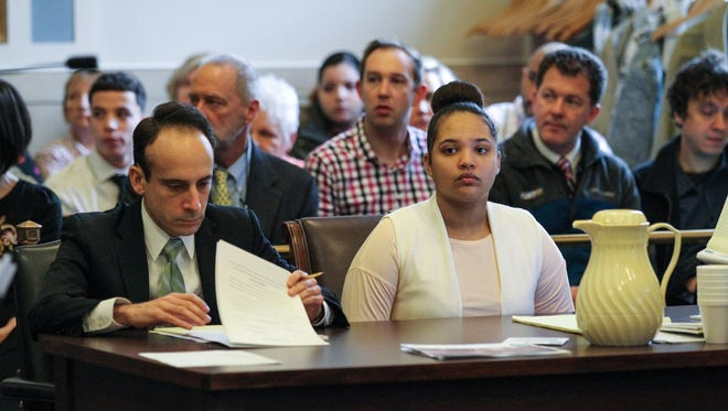 Briana Benson and her attorneys listen to closing arguments in her murder trial on Wednesday Feb. 14, 2018.
