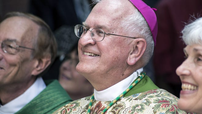 Louisville Archbishop Kurtz was all smiles during the dedication and blessing of the new Mother Catherine Spalding statue at the Cathedral of the Assumption on Sunday afternoon. 