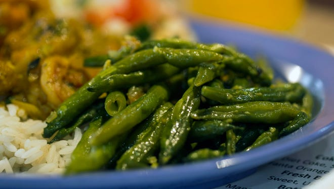 String beans are one of the side options with the shrimp curry at Naila's Caribbean Cuisine. 2/14/18