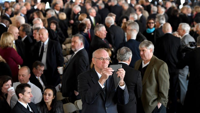 Guests arrive for the private funeral service for Billy Graham in a tent outside the Billy Graham Library in Charlotte, N.C. on Friday, March 2, 2018.