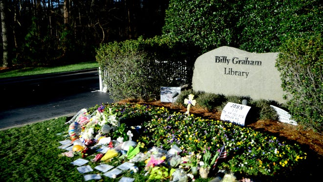 The rock marking the entrance to the Billy Graham Library before the private funeral service for Billy Graham in a tent outside the Billy Graham Library in Charlotte, N.C. on Friday, March 2, 2018.