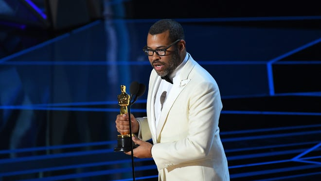"""As Jordan Peele accepted the Oscar for original screenplay, his """"Get Out"""" cast went nuts."""