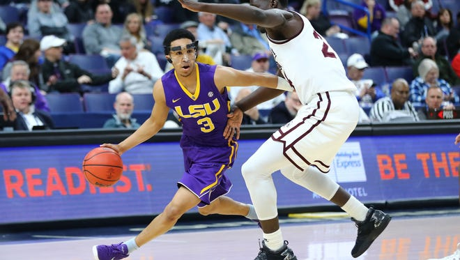 LSU Tigers guard Tremont Waters (3) drives around Mississippi State Bulldogs forward Abdul Ado (24) during the first half of the second round of the SEC Conference Tournament at Scottrade Center. Mandatory Credit: Billy Hurst-USA TODAY Sports